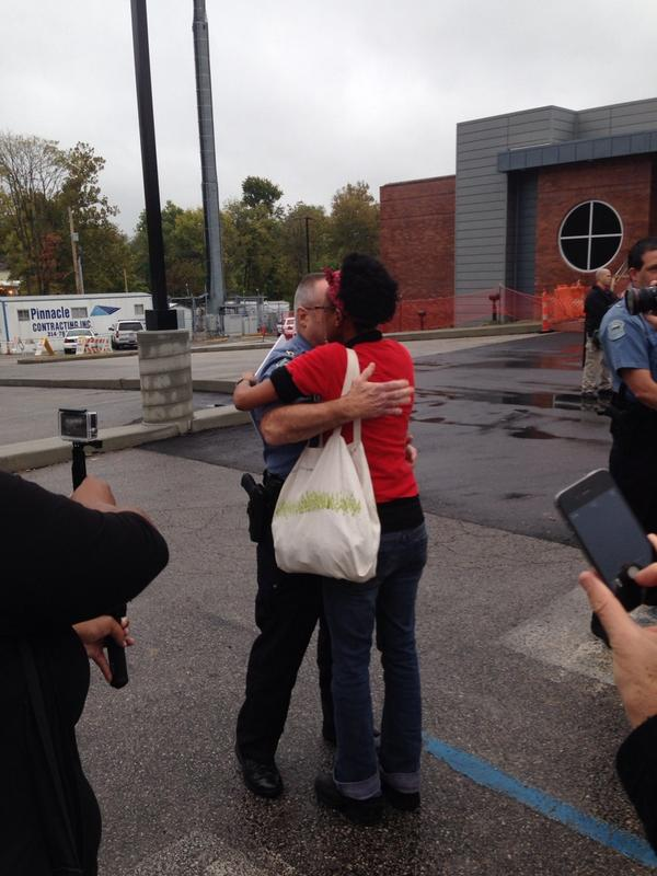 "Protester says to #ferguson police officer ""I want to hug u not hate u."" Then hugs him. #fergusonoctober http://t.co/5SObePnhCl"