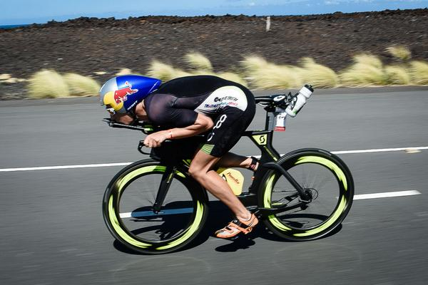 Don't try this at home. @SebastianKienle gets as aero as possible while riding his way to the #IMKona victory. http://t.co/Xb8TRie6K5