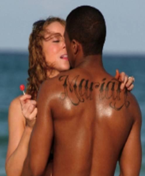 Forgot he had this  RT @necolebitchie: Nick Cannon Covers Up His Massive 'MARIAH' Tattoo http://t.co/gbweLXtq4u http://t.co/GMa4b32bpE