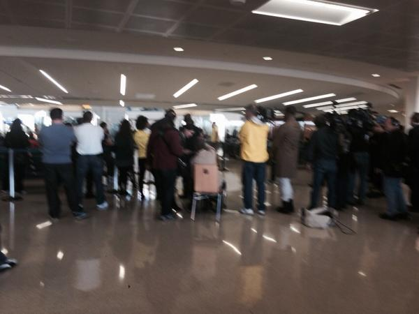 News crews and people waiting for passengers getting off of United flight 998 from Brussels http://t.co/OoDrgswKhq