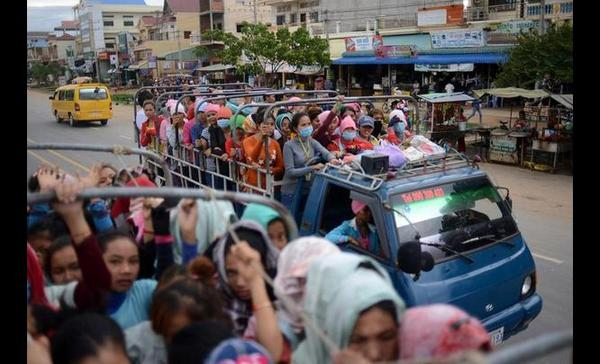 This is how the #Cambodian women who made your #Gap shirt & H&N pants commute to work everyday http://t.co/wRkvVjUBAi http://t.co/bdBWlCC7aq