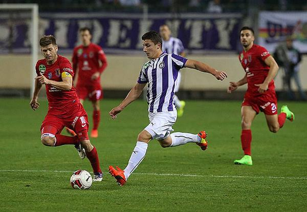 Bardhi (in white/purple) is shown during the game