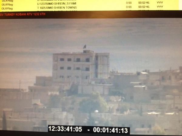 From a Reuters feed, said to be #ISIS flag on building in #Kobani #Syria #Turkey http://t.co/Q0YoekzDet