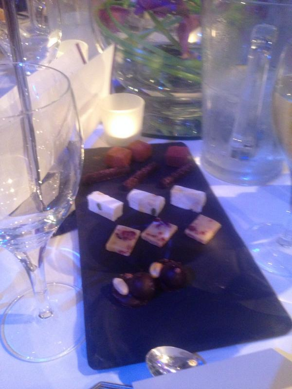PoB update: am on a table next to Joey Essex. He just tried to butter his bread roll with a cube of nougat. http://t.co/803flPbpT2