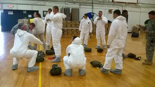 #HappeningNow Soldiers deploying to Liberia testing out the elasticity of the TYVEX suit http://t.co/kK4HHPithA