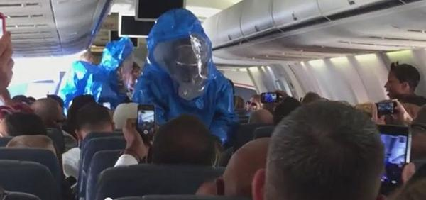 Pro tip: don't joke about Ebola on a flight because this is what will happen. http://t.co/iZMNA84d9L http://t.co/0rcGFScI5u