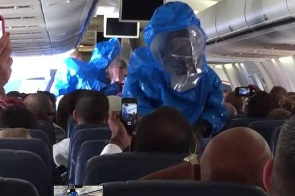Man on plane sneezes and jokes 'I have ebola'.  You can guess what happened next: http://t.co/do9WZBl12V http://t.co/HAl61grPoD