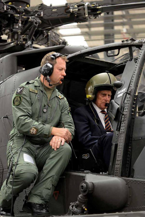 Prince Philip Gets Behind The Controls Of An Apache Helicopter With 7 Air Assault Battalion