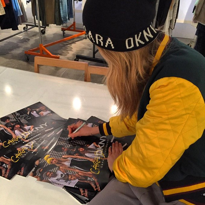 Getting ready for tomorrow! Signing posters to hand out to the first 100 customers who get a piece of