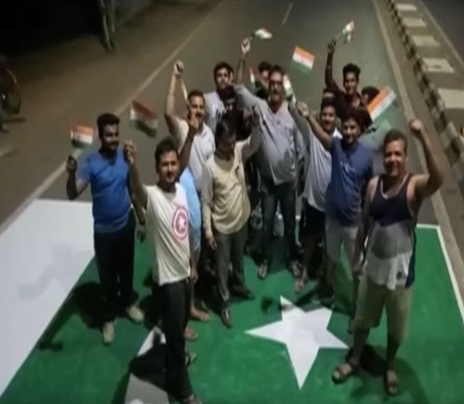 Youths in Anand draw Pakistan flag on road, stand on it with tricolors