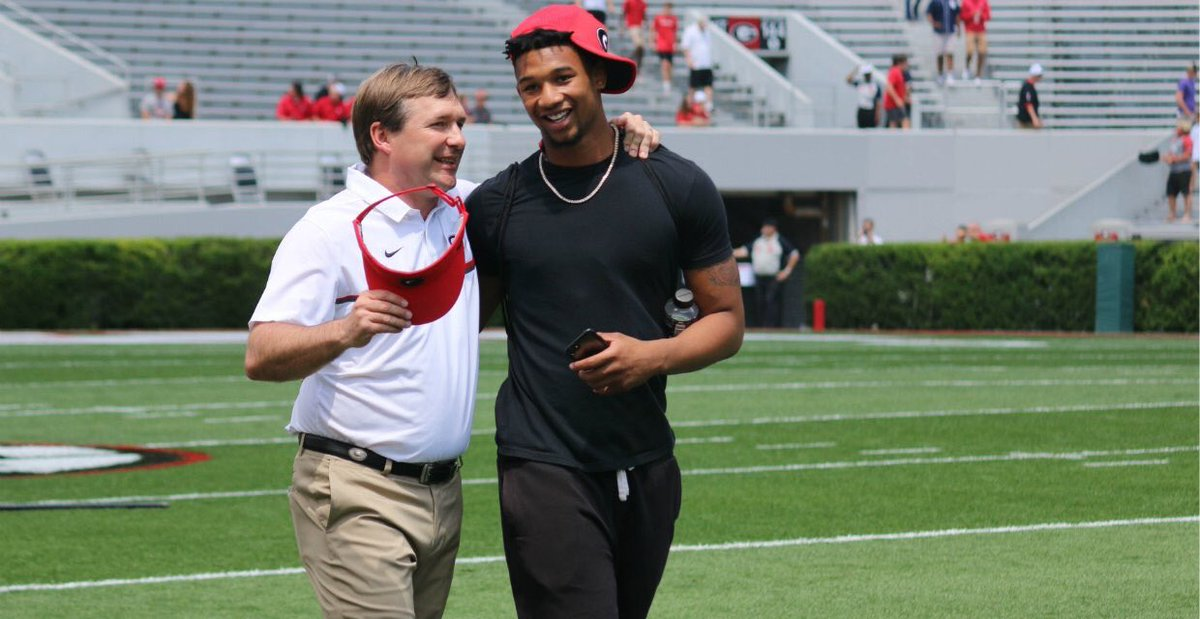 Michael Harris (right) with Georgia Head Coach Kirby Smart - Class of 2018 LB (Photo from Michael Harris/Twitter)