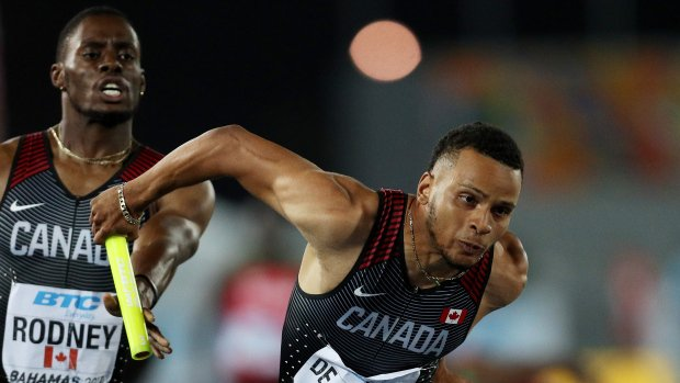 De Grasse, Canada rebound to win 4x200 gold https://t.co/cIXjHweuiL ht...