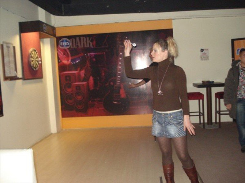 Now this is the kind of dart league I could get into... sexy blonde in a short jean skirt, boots and pantyhose