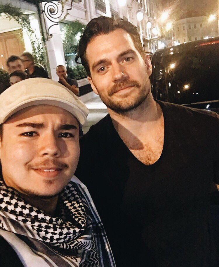 new pics of henry in paris (mustache included) https://t.co/dZYIad9RsV