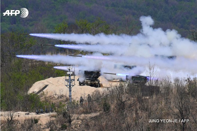 All fired up: Kooryong rockets are launched at S.Korea-US live-fire drill in Pocheon, as North Korea hails own largest-ever artillery drill