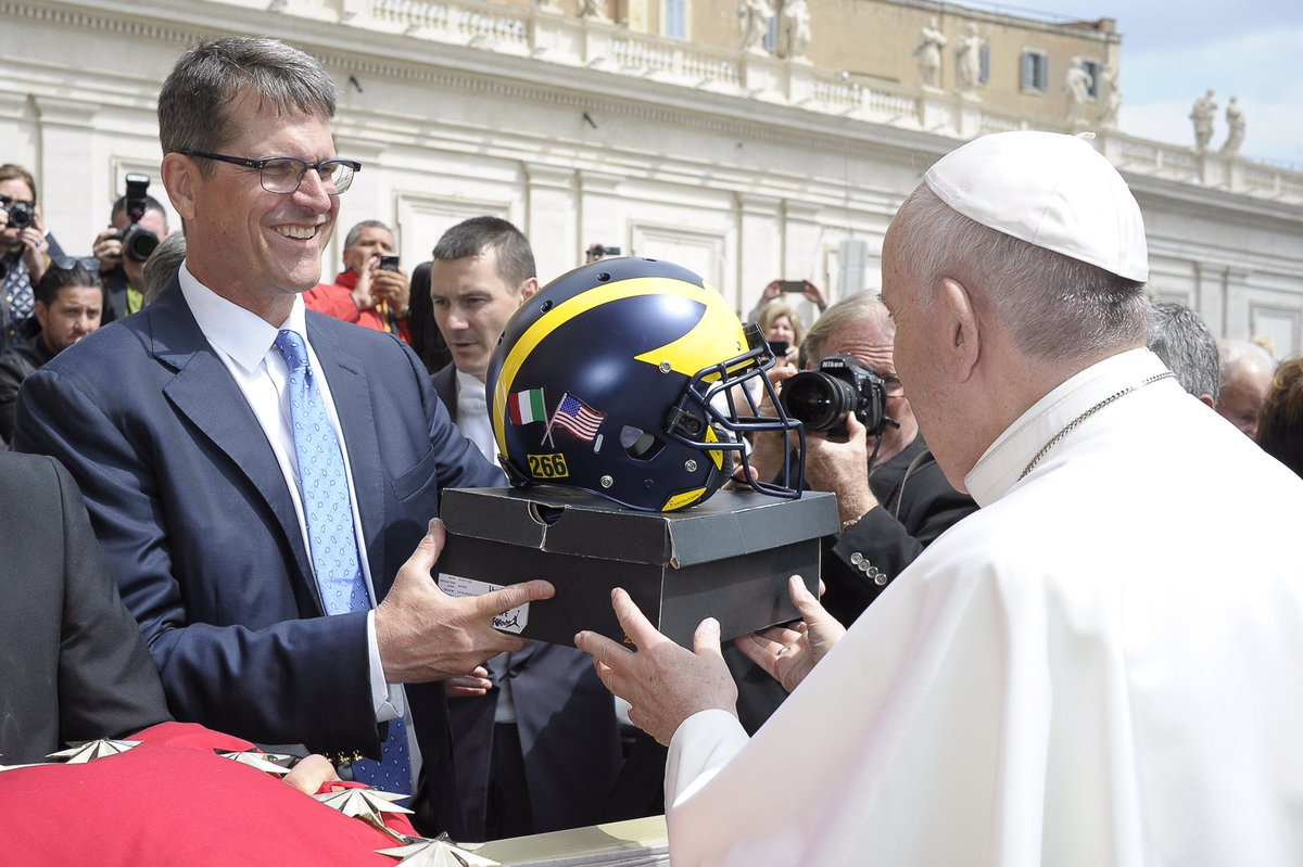 Jim Harbaugh gave Pope Francis a Michigan helmet and a pair of Jordans