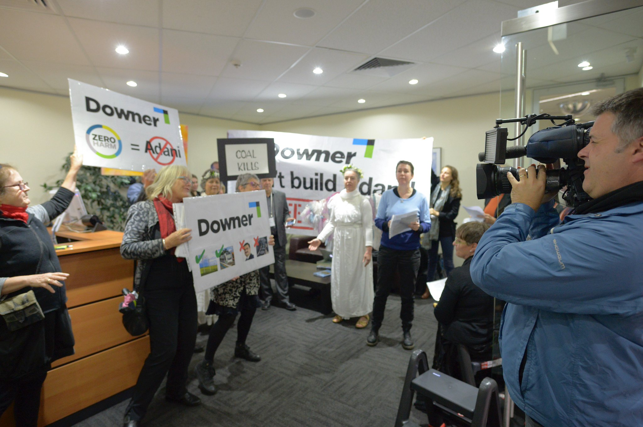 Occupation of @downergroup office Melbourne continuing. Activists locked on to the door. Downer CEO has not responded to #StopAdani request https://t.co/zSmCU1XULf