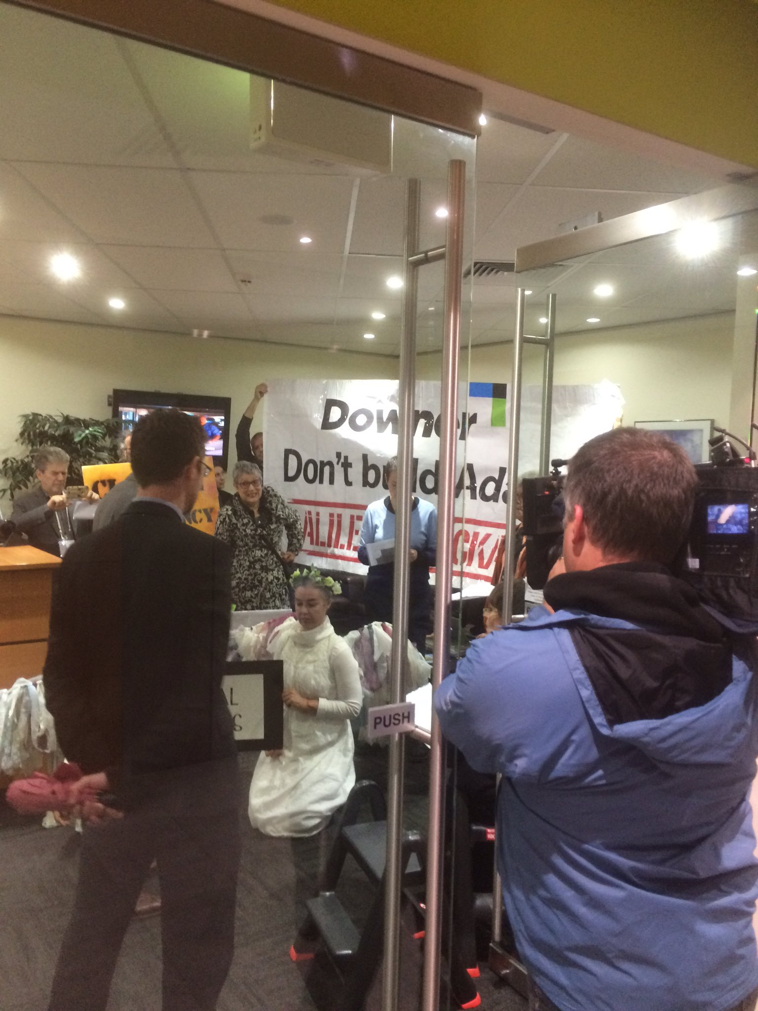 Concerned citizens are occupying the foyer of a Downer office to beg them not to build the Adani mine. #StopAdani @Downergroup #Auspol https://t.co/GNTSR3Sixc
