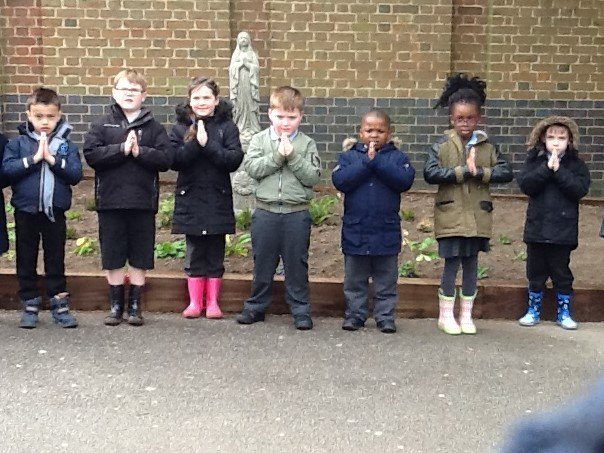 Year One pausing to reflect at the new prayer garden.@OfficialWiseman