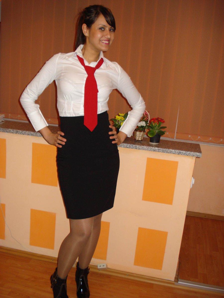 Knee length skirt, boots and shiny pantyhose.  Nice look!