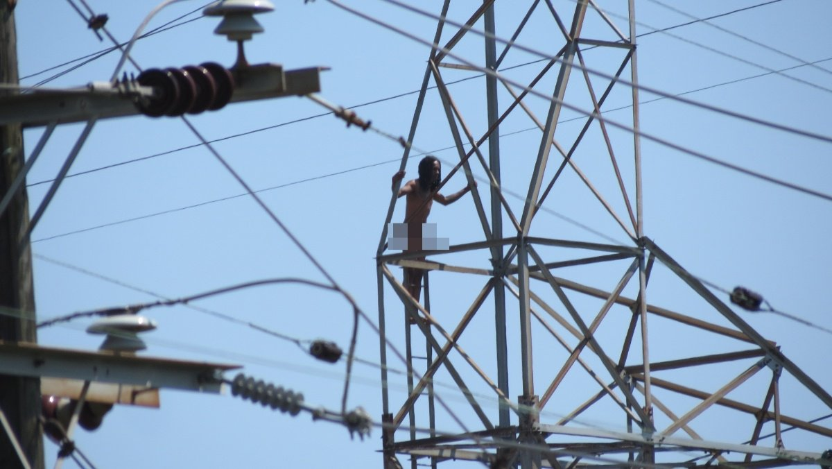 Watch live: naked man climbs electric tower in new orleans east ...