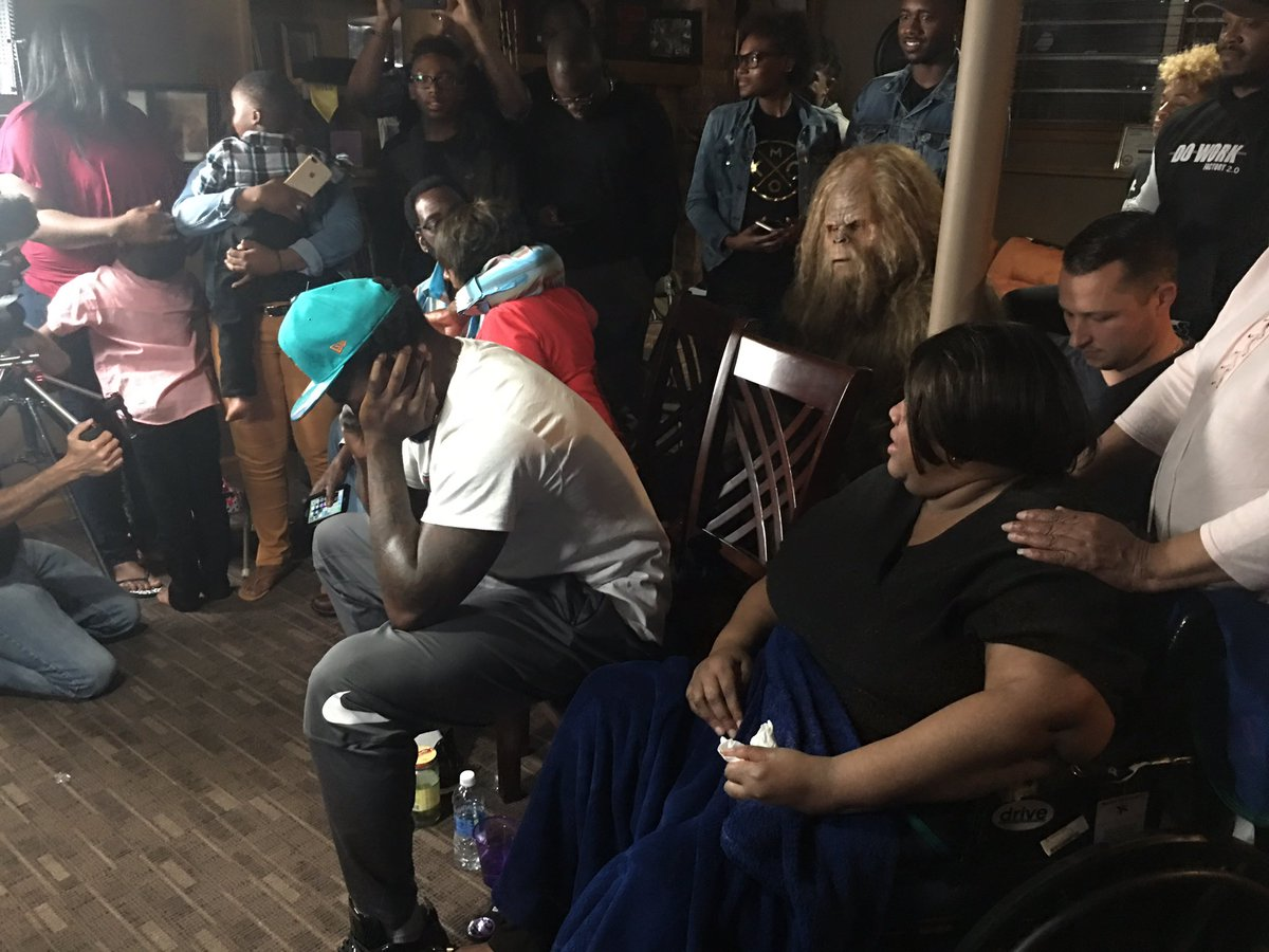 Charles Harris emotional along with his mother next to him sporting hi...