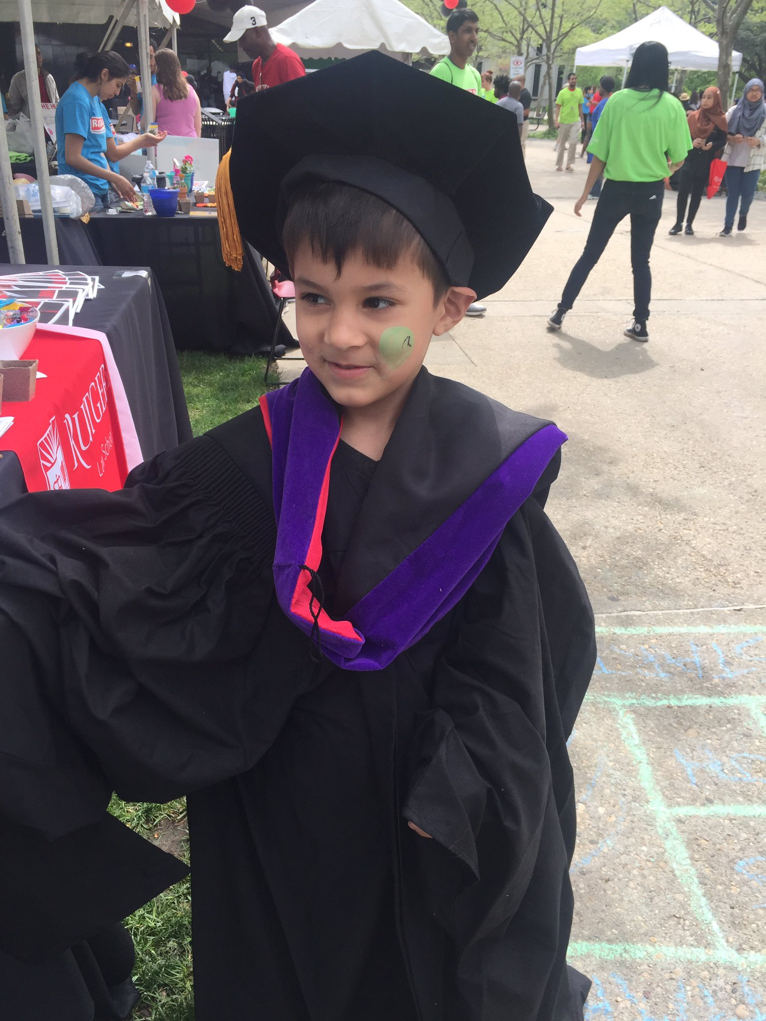 Five-year-old John Theo tries on a law school graduation robe.  #RutgersDay https://t.co/g6rTySQjHx
