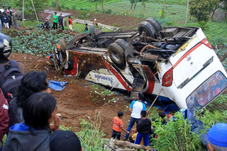 At least 11 killed after bus tumbles down slope in Indonesia