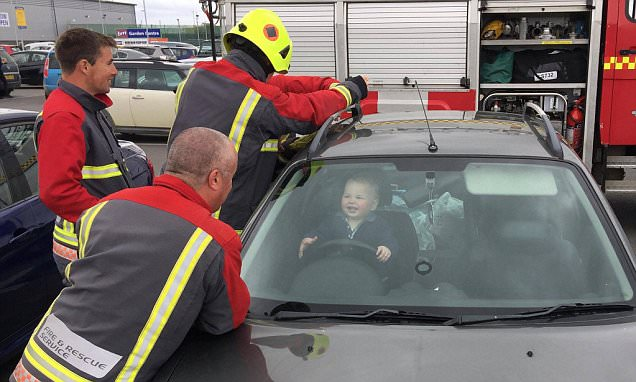14-month-old British boy who accidentally locked himself in his mom's car laughs as 5 firefighters try to free him on Friday in Cornwall, UK