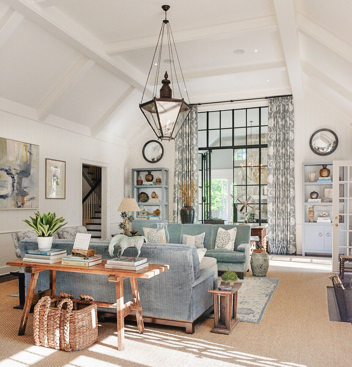 Blue decor in living room with steel and glass doors and transom. Southeastern Designer Show House. #livingroom #lantern #decorinspiration