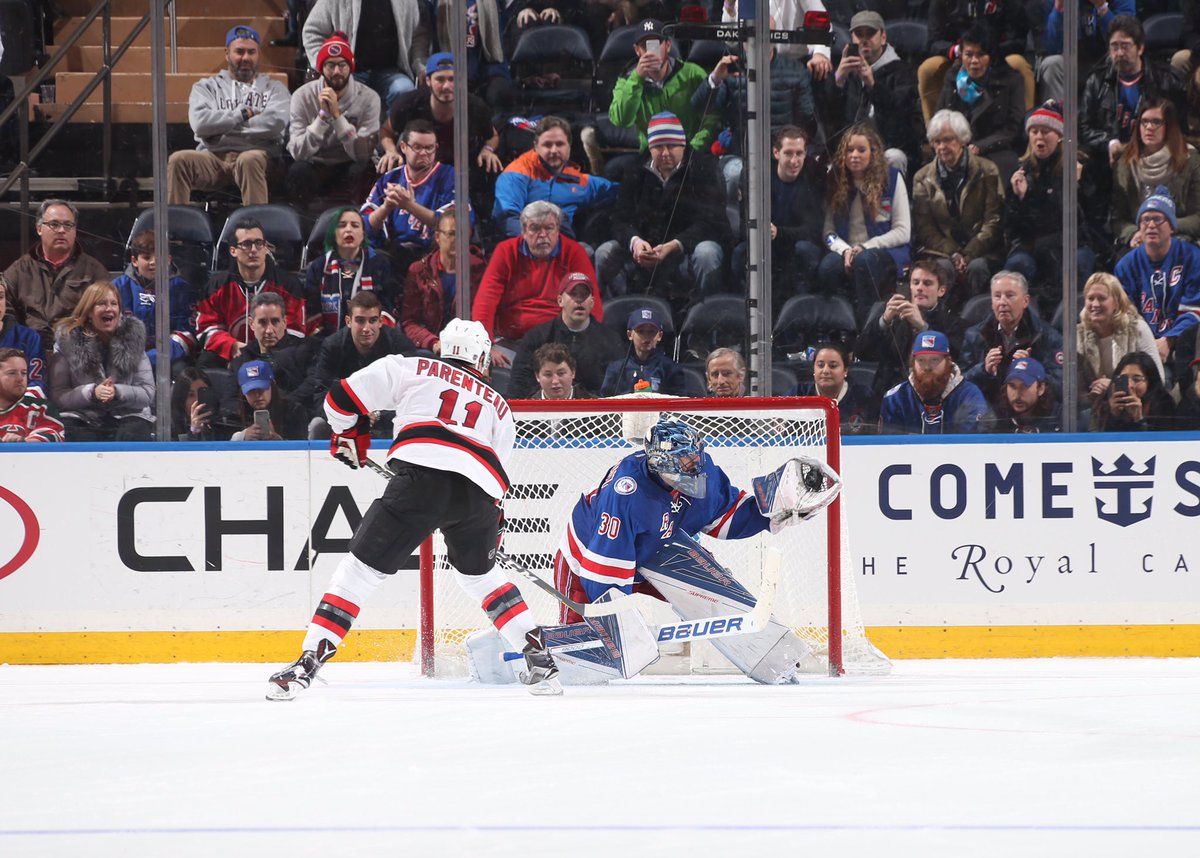 Henrik Lundqvist makes a glove save on P.A. Parenteau in the shootout. AP Photo via Getty Images courtesy NYRangers.
