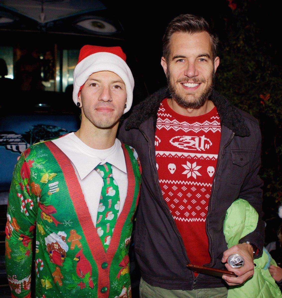 Holiday sweaters in effect! @joshuadun of @twentyonepilots & @NickHexum of @311 taking in a holiday party! https://t.co/ERuRiVyPKp