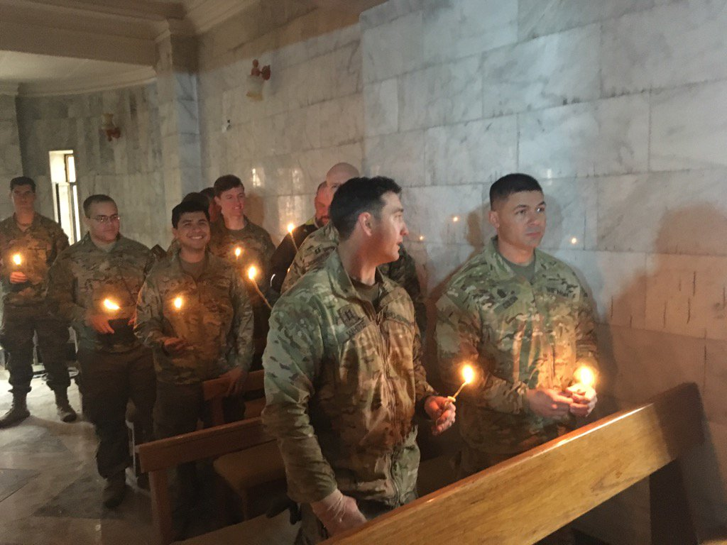 American soldiers attend the 1st service in Bartalla, Iraq after its recapture from IS, held on Christmas Eve.