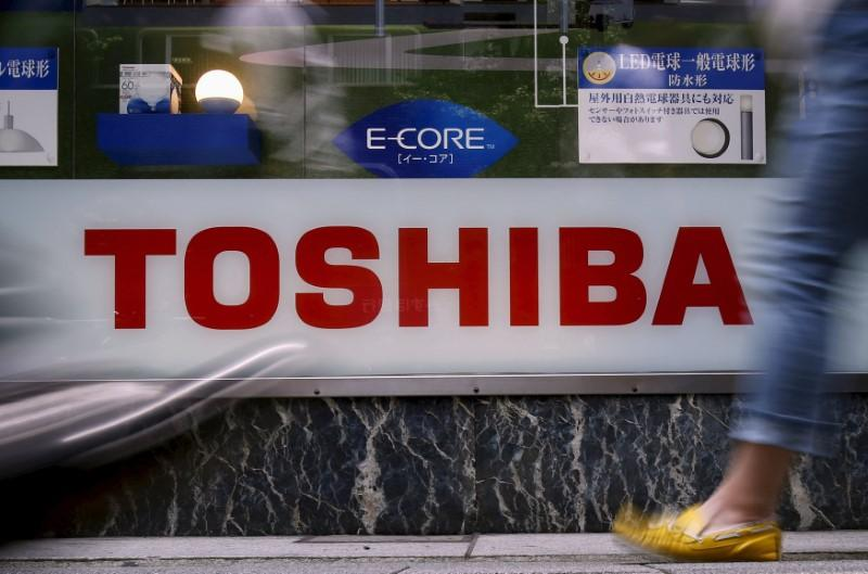 Toshiba shares untraded amid heavy sell orders on news may book steep charges