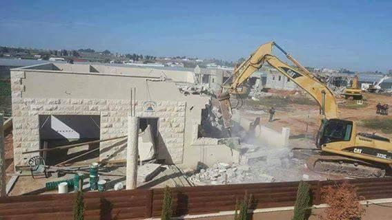 Israeli authorities demolished 11 Palestinian homes in  Qalansuwa today