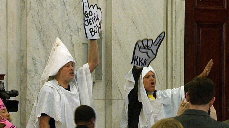 Before Jeff Sessions' confirmation hearing for attorney general began, protesters wearing KKK garb were escorted out