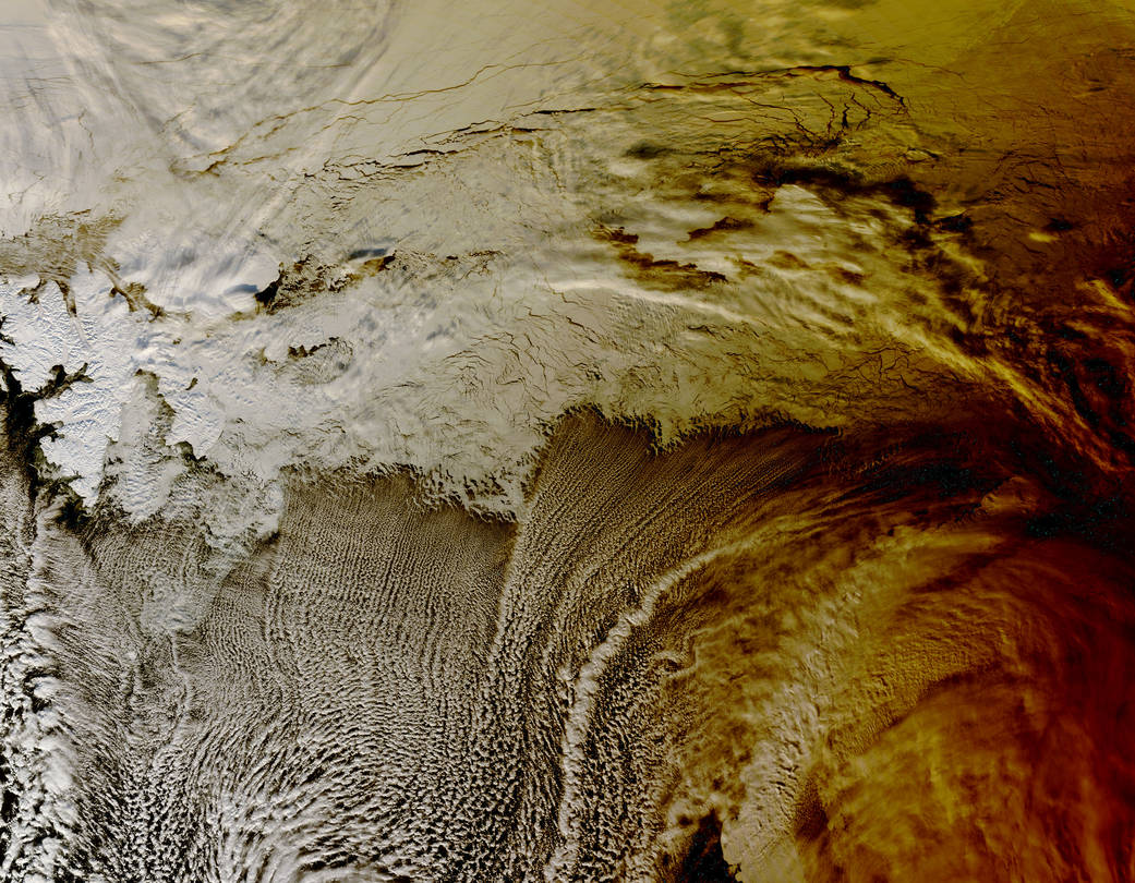 NASA\'s Terra satellite passed over the Arctic Ocean and captured the an eclipse\'s shadow over clouds. #WhatOnEarth  ��