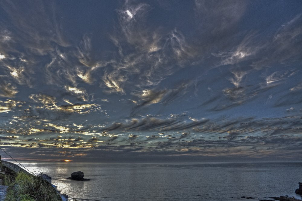 Cornish 'mackerel sky' taken by @BigFatPhotoCo