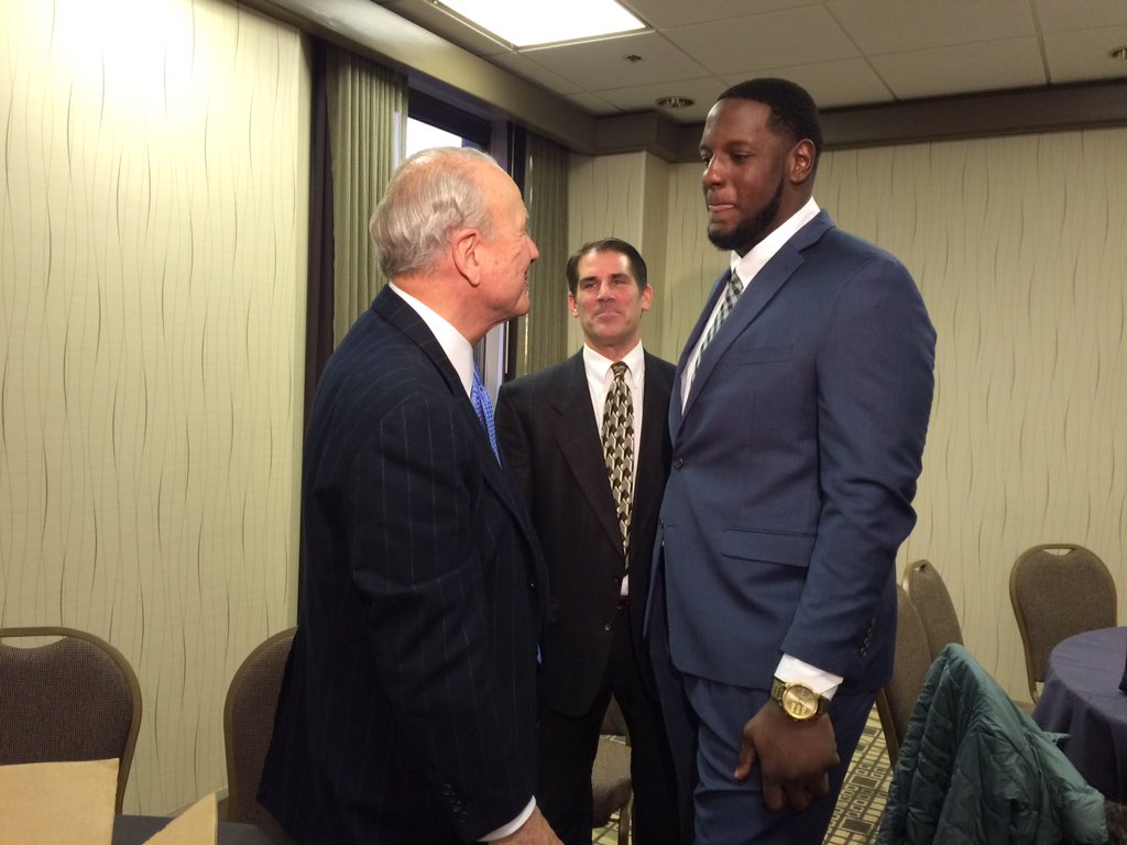 Cam Robinson speaks with legendary head coach Barry Switzer before ton...
