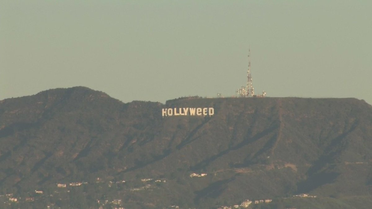 """Take a look at what our cams captured – someone has modified the signage of the famed Hollywood sign to read """"Hollyweed."""" More soon.."""