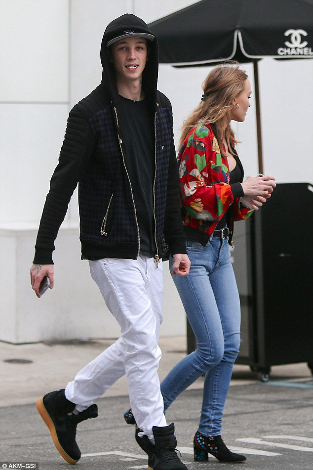 f1568f32c527 lily rose depp shops at chanel with boyfriend ash stymest in beverly hills