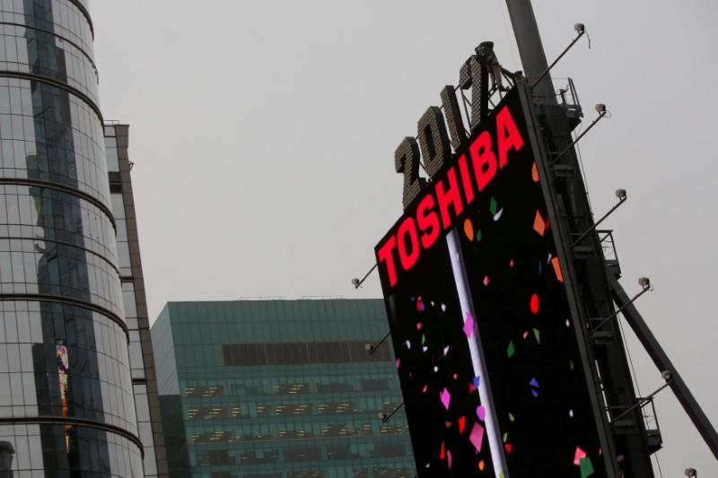 Ahead of key lender meetings, battered Toshiba expects support