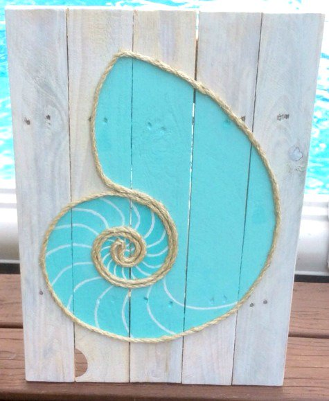 Rope Wall Art: www.completely-co... Shell outlined with rope on wood, and many other ocean inspired creations.