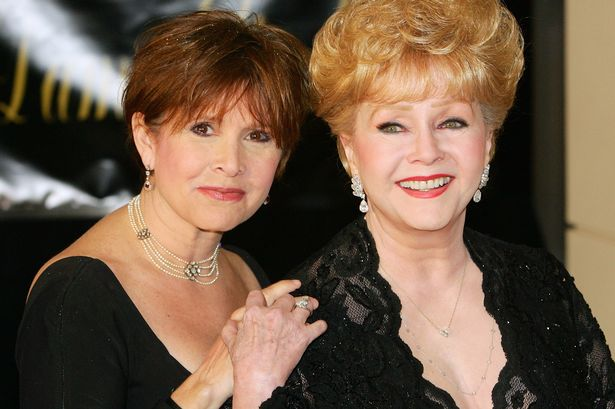 (Daily Record):#Debbie #Reynolds and daughter Carrie Fisher laid to rest together after..  http://www. newsoneplace.com/article/618143 1612/debbie-reynolds-carrie-fisher-los-angeles-daughter-touching-memorial-service &nbsp; … <br>http://pic.twitter.com/7C1XmqPRgj