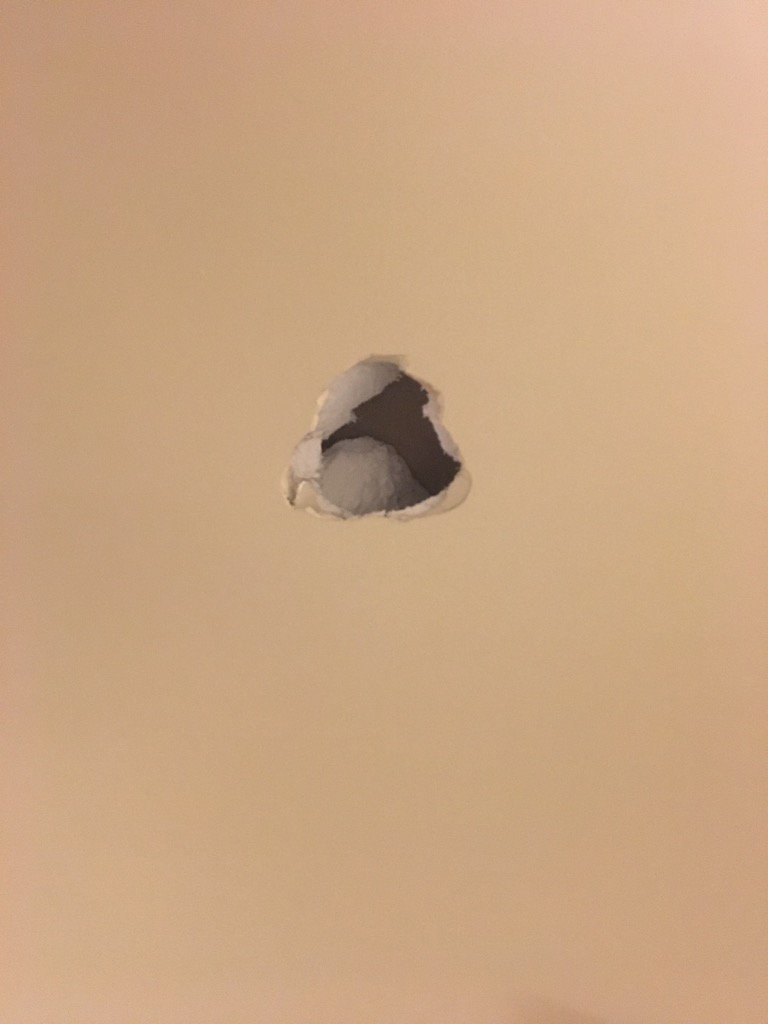 The now infamous hole in the wall outside visitor interview room, reportedly courtesy of @obj_3 https://t.co/WagfLODWDc