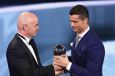 Ronaldo of Portugal/Real Madrid accepts Best FIFA Men's Player Award from FIFA President Infantino during The Best FIFA Football Awards