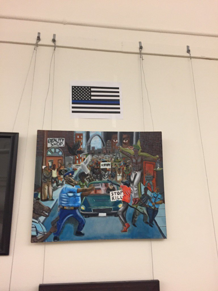 A Blue Lives Matter flag is now afixed to the wall above the controversial pigs as police painting on Capitol Hill https://t.co/w8xcWHpBEm