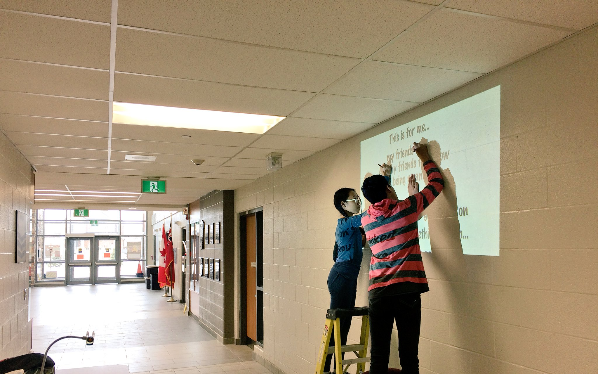 Bullying prevention pledge being stencilled on the wall by some #grade8sam leaders @SMCDSB @SMCDSB_SAM https://t.co/Ibwi9OjrLo