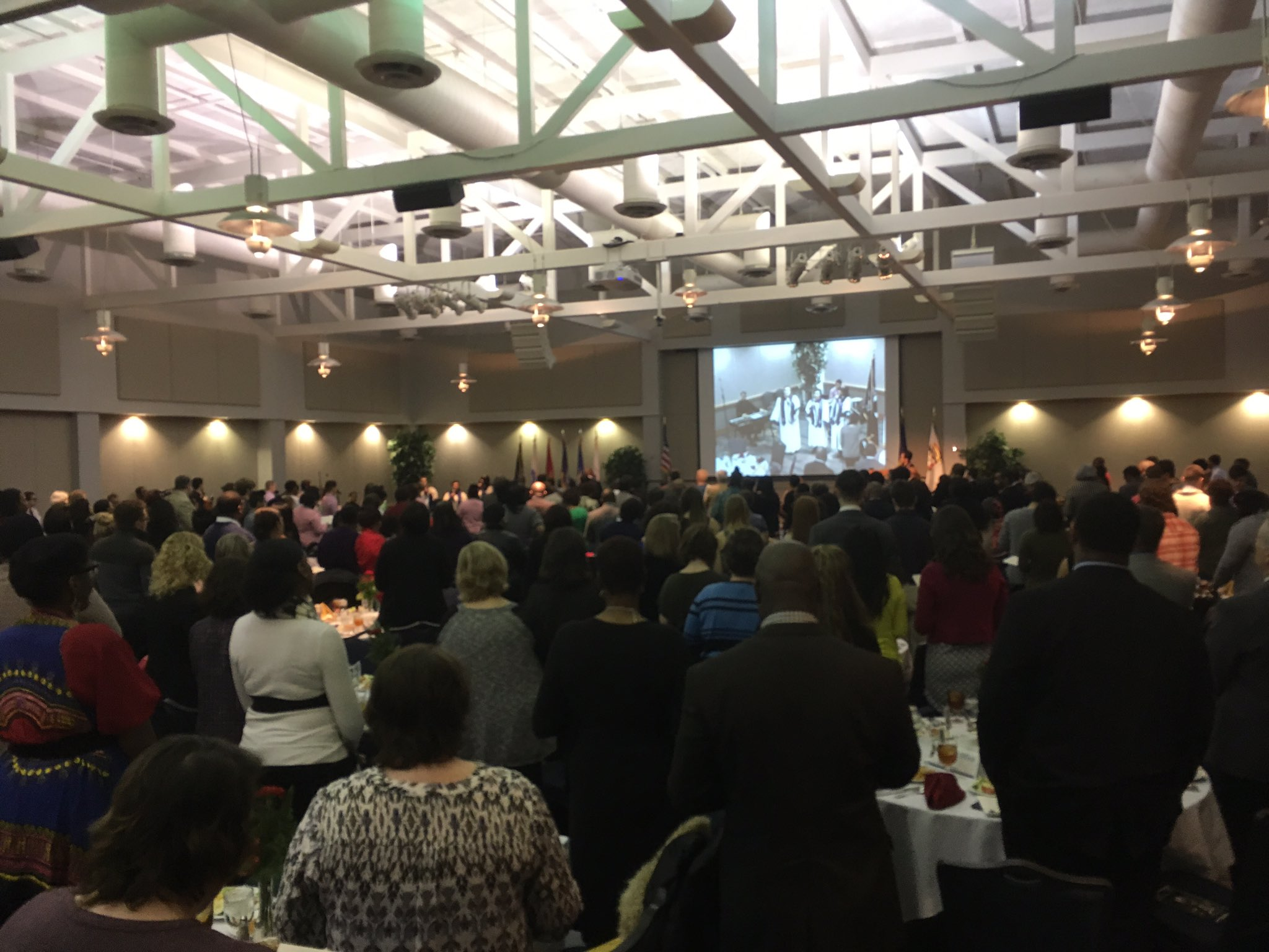 """Members of the Designed by Grace gospel choir leading the attendees in """"Lift Every Voice"""". #USIMLK https://t.co/MKw6ZfJEkm"""
