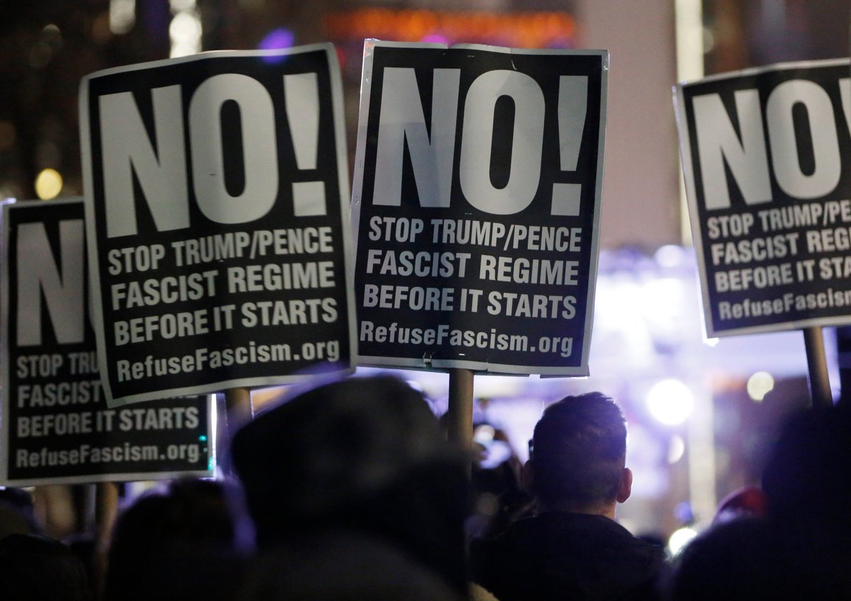 Protesters gather outside Trump International Hotel in New York City a...